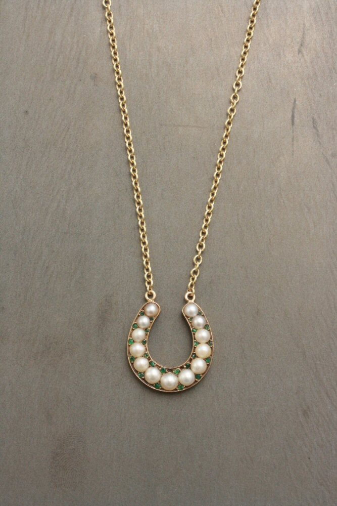 Adelphe-Pearl-And-Emerald-Horseshoe-Necklace